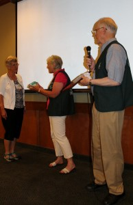 Lynda Pheasant accepts Fred's President's Award from Roxanne Lowe and Mike McKinnon